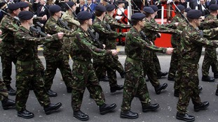 Members of the Territorial Army parade down Kensington High Street, London