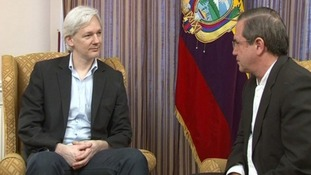 Julian Assange and Ecuador's foreign minister Ricardo Patino inside the Ecuadorian embassy.