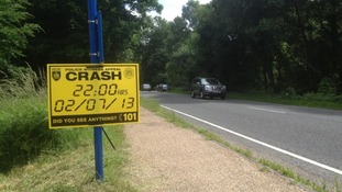 Sign appealing for witnesses of crash