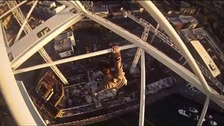 James Kingston hanging from a crane