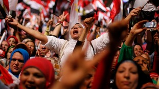 Protesters celebrate as Egypt's military removes President Mohamed Morsi