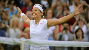Belgium's Kirsten Flipkens celebrates victory in her quarter final match at Wimbledon