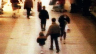 James Bulger seen in 1993 being led away at a shopping centre in the Bootle area of Liverpool