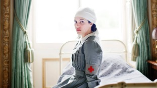 "Jessica Brown Findlay as ""Lady Sybil Crawley"" in her nurse's outfit"
