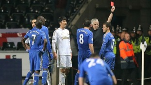 Chelsea's Eden Hazard received a red card from referee Chris Foy for violent conduct.