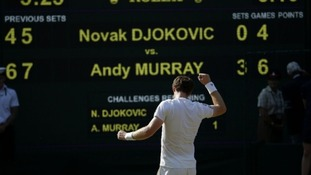 Andy Murray in front of the score board after defeating Serbia's Novak Djokovic