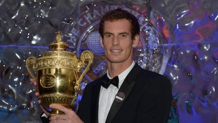 Andy Murray poses with the mens singles trophy during the Champions Ball at the Intercontinental Hotel in London