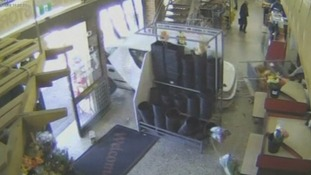 An elderly woman crashes through the front window of a supermarket in Melbourne, Australia.