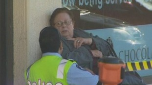 The elderly driver pictured outside the supermarket after the accident.