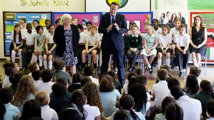 David Cameron addresses children at St Mary's and St John's CE School in north London.