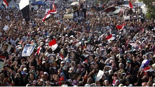 Pro-Morsi supporters shout slogans as they rally at Cairo's Raba El-Adwyia square