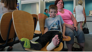 Ryan and his mother Alison waiting to be seen in the mior injuries clinic.