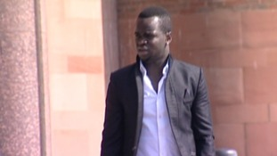 Newcastle United midfielder Cheick Tiote talks on the phone outside Newcastle Magistrates' Court
