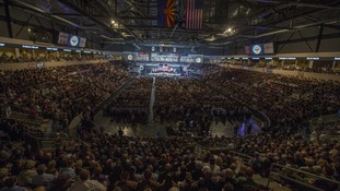 Mourners wait for the start of the memorial service in Prescott Valley, Arizona