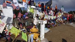 A fence in Prescott, Arizona has become a virtual shrine to the firefighters with hundreds of mementos left