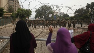 Women supporting the deposed Egyptian President Mohamed Morsi shout at members of the Republican Guard