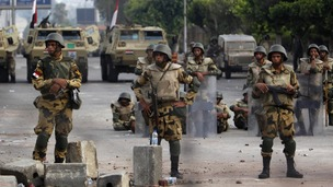 Soldiers on duty outside the Republican Guard headquarters in Cairo