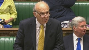 Business Secretary Vince Cable addresses the House of Commons.
