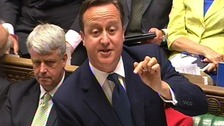 Prime Minister David Cameron speaks during Prime Minister's Questions today.