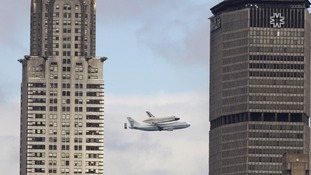 The shuttle is flown across New York.