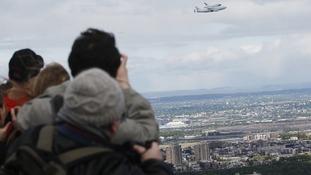 Spectators watch Enterprise's final flight.