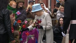 The Queen receiving flowers