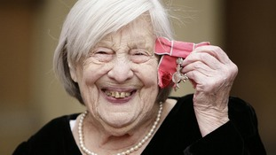 Former EastEnders actress Anna Wing pictured holding her MBE in November 2009.