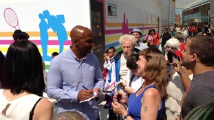 Cyrille Regis meeting fans at the opening of the New Square shopping centre.