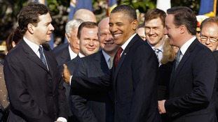 US President Barack Obama pats Chancellor George Osborne on the arm