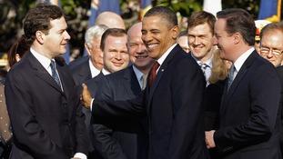 US President Barack Obama pats Chancellor George Osborne on the arm