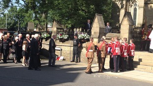 The coffin of Fusilier Rigby is carried into Bury Parish Church ahead of a vigil