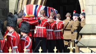 The coffin of Drummer Lee Rigby is carried into Bury Parish church.
