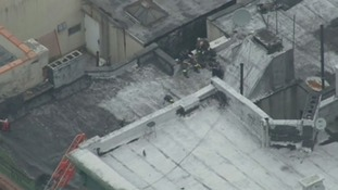 Firefighters on the roof of the building