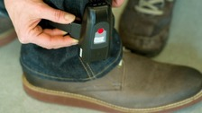An offender wears an electronic tag