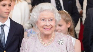 The Queen watches the proceedings at Buckingham Palace