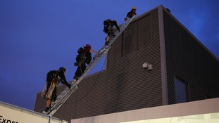 The ascent began this morning with the protesters climbing out of the roof of a parked lorry
