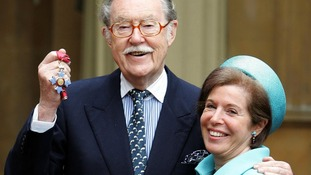 Alan Whicker with his partner Valerie Kleeman in 2005, when he received his CBE.