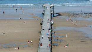 Families enjoy the hot weather at Saltburn-by-the-Sea, North Yorkshire.