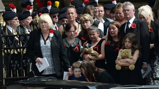 Family members watch as the coffin of murdered Fusilier Lee Rigby is carried from Bury Parish church.