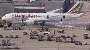 Emergency services can be seen surrounding the Ethiopian Airlines planes at Heathrow.