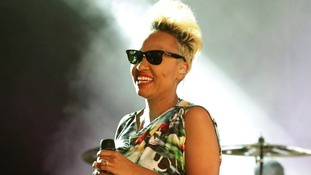 Emeli Sande performing as a guest with Naughty Boy