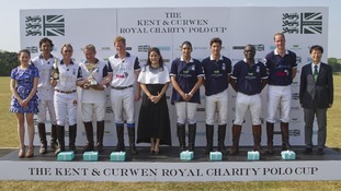 The polo teams in The Kent & Curwen Royal Charity Polo Cup with the Duke of Cambridge (2nd right) and Prince Harry (5th left).
