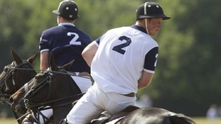 The Duke of Cambridge (left) and Prince Harry (right) playing polo against one another.