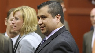 George Zimmerman raises a smile after the verdict is read out in court.
