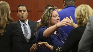 George Zimmerman's wife, Shellie (centre), celebrates with family and friends following her husband's not guilty verdict.