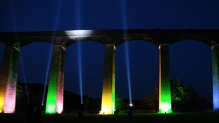 Aquaduct illuminated at night