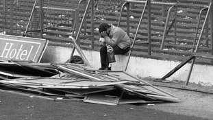A Liverpool fan sitting on the terraces at Hillsborough after the disaster