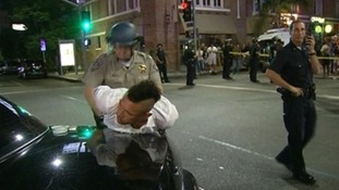 A man is arrested during the protests