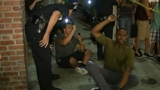 Police officers attempt to move protesters during a sit-in