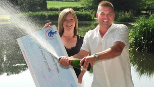 David and Dawn with their million pound cheque